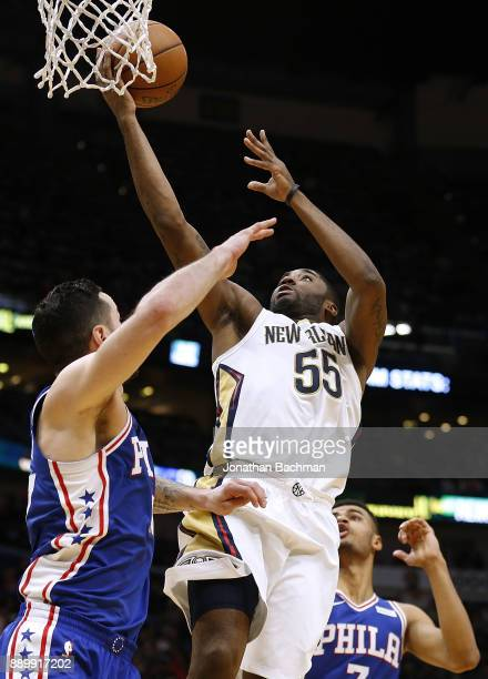 Twaun Moore of the New Orleans Pelicans shoots against JJ Redick of the Philadelphia 76ers during the second half of a game at the Smoothie King...