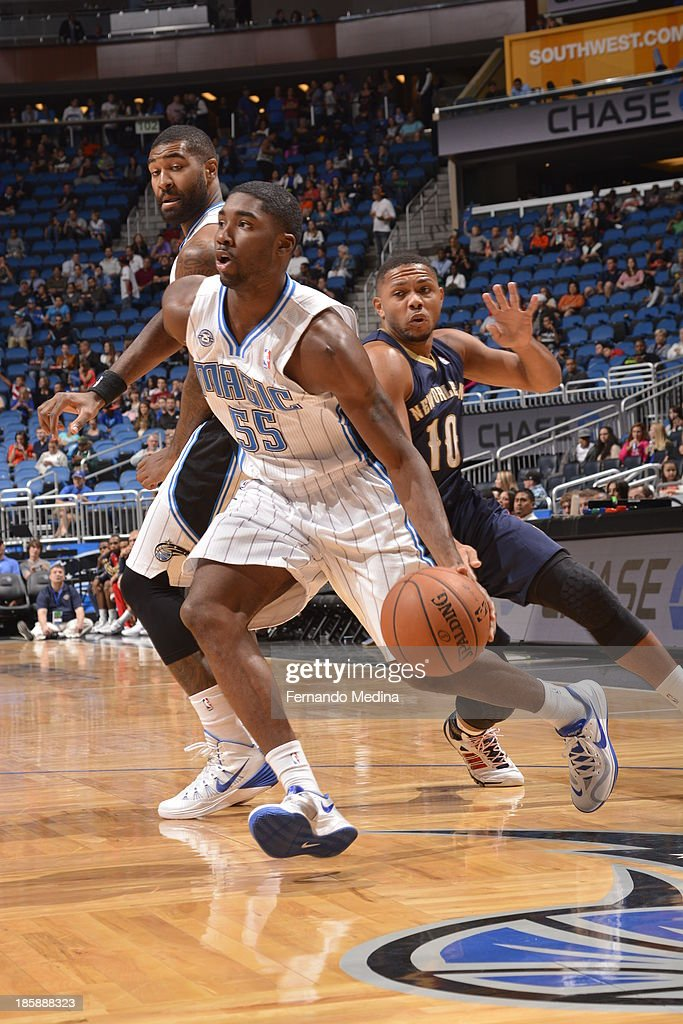 E'Twaun Moore #55 of the Orlando Magic drives to the basket against the New Orleans Pelicans the game on October 25, 2013 at Amway Center in Orlando, Florida.