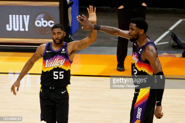 Twaun Moore of the Phoenix Suns and Deandre Ayton high five during the first quarter against the LA Clippers during game two of the NBA Western...