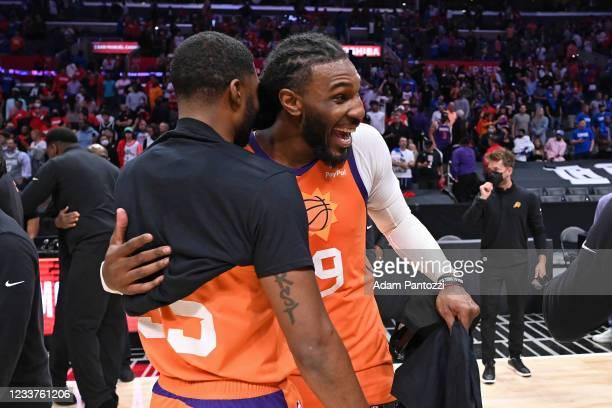Twaun Moore of the Phoenix Suns hugs Jae Crowder of the Phoenix Suns after the game against the LA Clippers during Game 6 of the Western Conference...