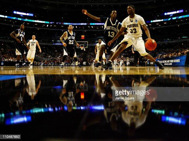 Twaun Moore of the Purdue Boilermakers drives on Steven Samuels of the St Peter's Peacocks in the first half during the second round of the 2011 NCAA...