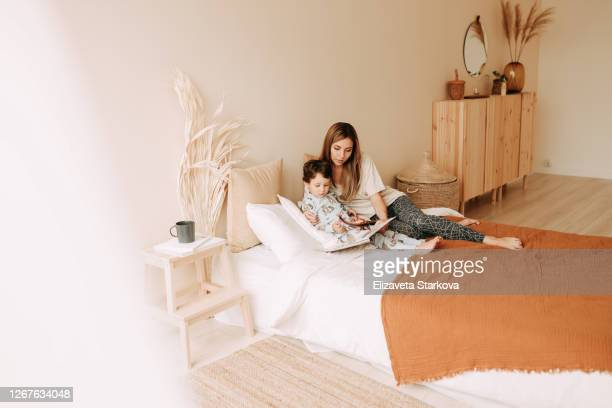 tween boy and mother playing in bedroom at home - school cane stock pictures, royalty-free photos & images