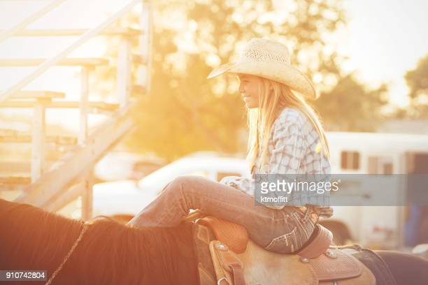 Tween Cowgirl Waiting On Horse At Rodeo