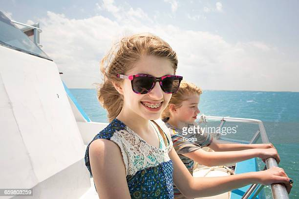Tween girl and brother on boat ride