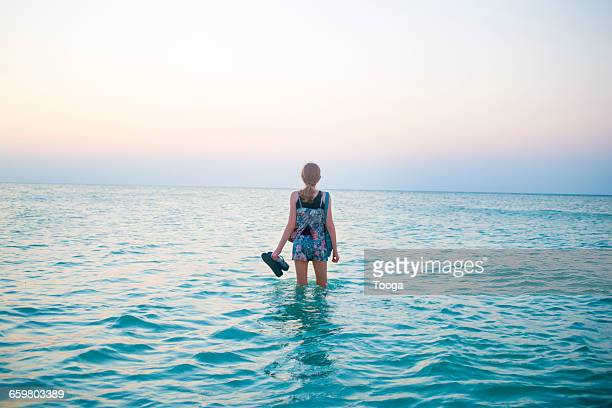 tween girl in ocean - forever young stock pictures, royalty-free photos & images
