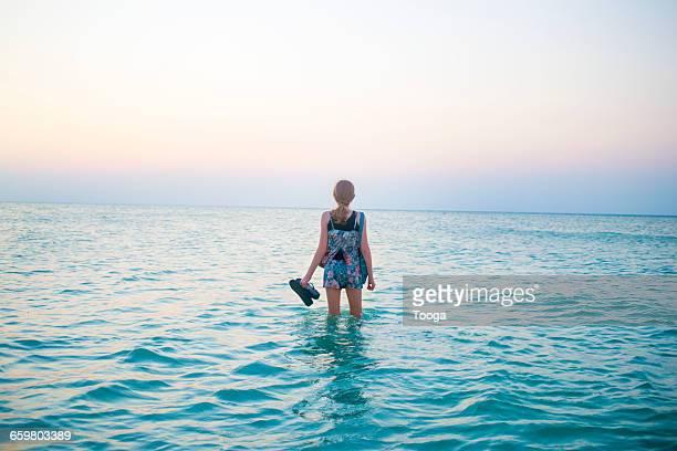 Tween girl in ocean