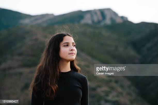 tween girl standing outside with mountain in the background - thousand oaks stock pictures, royalty-free photos & images
