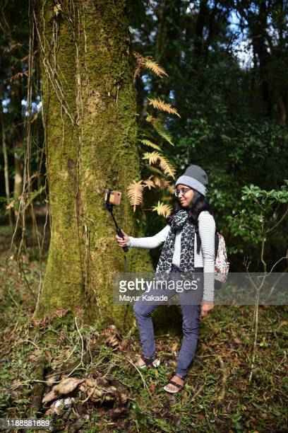 tweenage girl (10-11 years) girl taking selfie in the forest - 10 11 years stock pictures, royalty-free photos & images
