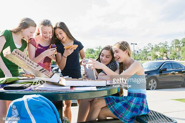 Tweens texting & eating while doing homework after school