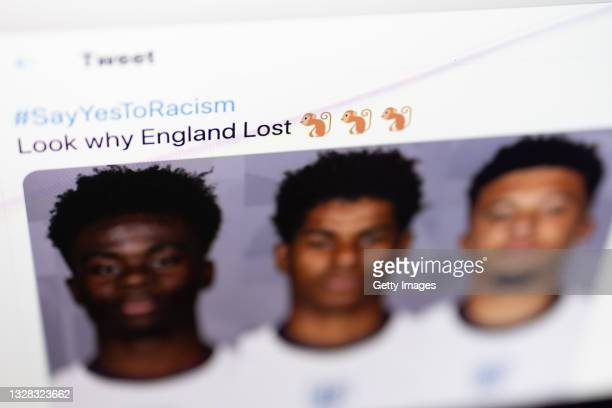 Tweet featuring racist content directed at the England football team is seen on July 12, 2021 in London, England. England manager Gareth Southgate,...