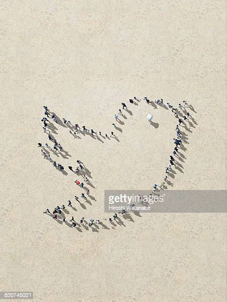 tweet icon made out of walking people - online messaging stock pictures, royalty-free photos & images