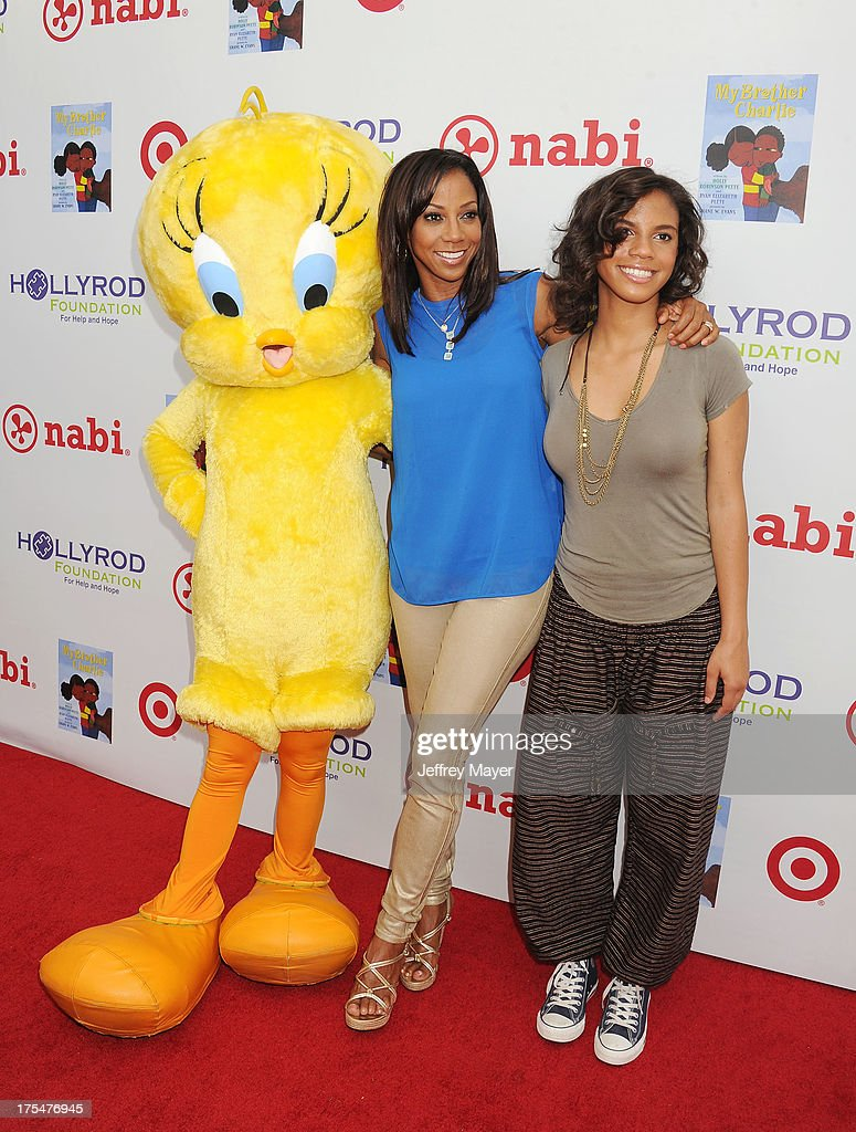 Tweety Bird, actress Holly Robinson Peete and daughter Ryan Elizabeth Peete arrive at HollyRod Foundation's 4th Annual 'My Brother Charlie' Carnival at Culver Studios on August 3, 2013 in Culver City, California.