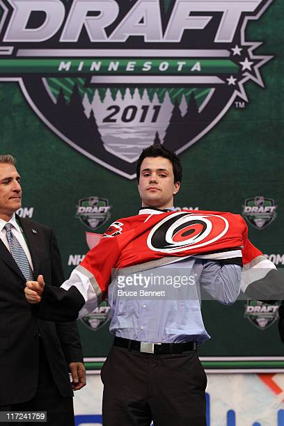 Twelfth overall pick Ryan Murphy by the Carolina Hurricanes puts on a Carolina Hurricanes jersey onstage during day one of the 2011 NHL Entry Draft...