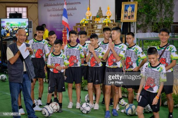 Twelve boys and their coach Ekkapol Chantawong from the Wild Boars soccer team arrive for a press conference for the first time since they were...