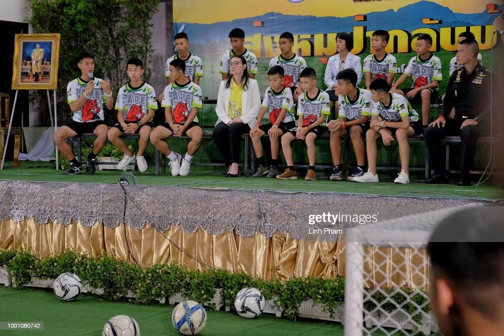 Twelve boys and their coach, Ekkapol Chantawong (Left), from the 'Wild Boars' soccer team speak during a press conference for the first time since they were rescued from a cave in northern Thailand last week, on July 18, 2018 in Chiang Rai, Thailand. The 12 boys, aged 11 to 16, and their 25-year-old coach were discharged early from Chiang Rai Prachanukroh hospital after a speedy recovery and thanked those involved in their rescue.