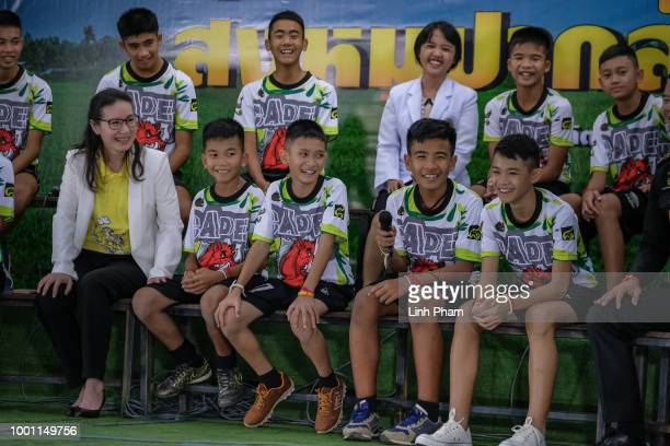 Twelve boys and their coach Ekkapol Chantawong from the 'Wild Boars' soccer team speak during a press conference for the first time since they were...