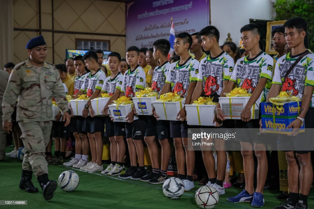 Twelve boys and their coach from the 'Wild Boars' soccer team receive gifts from local goverment during a press conference for the first time since they were rescued from a cave in northern Thailand last week, on July 18, 2018 in Chiang Rai, Thailand. The 12 boys, aged 11 to 16, and their 25-year-old coach were discharged early from Chiang Rai Prachanukroh hospital after a speedy recovery and thanked those involved in their rescue.