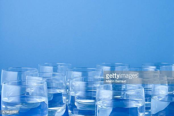 twelve glasses of water  - large group of objects stock pictures, royalty-free photos & images