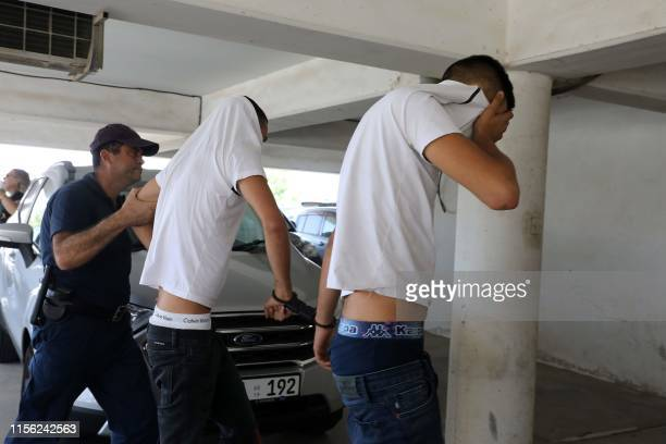 Twelve Israeli tourists suspected of raping a 19yearold British girl in Ayia Napa arrive to the court premises with their faces covered in Paralimni...