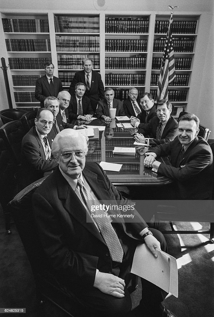 Twelve of the 13 Republican congressmen who managed the House Impeachment Trial of Bill Clinton gathered in a Committee Room on February 12, 1999, the day the US Senate voted to acquit Clinton on charges of perjury and obstruction of justice. The charges stemmed from Clinton's relationship with White House intern Monica Lewinsky. Congressmen seated from left, in front Henry Hyde (R-Ill.); Charles Canady (R-FL); Steve Buyer (R-Ind.); Jim Sensenbrenner (R-Wis.); Lindsay Graham (R-S.C.); Asa Hutchinson (R-Ark.); Steve Chabot (R-Ohio); George Gekas (R-PA); Bob Barr (R-GA); Chris Cannon (R-Utah); Bill McCollum (R-FL); and Jim Rogan (R-Calif). Not pictured is Ed Bryant (R-Tenn.).