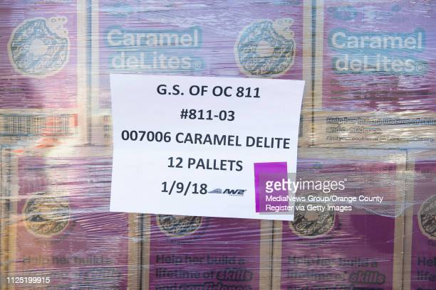Twelve pallets of Caramel deLites wait to be picked up during the Girl Scout Cookie Mega Drop at the Anaheim Business Complex in Anaheim on Saturday...