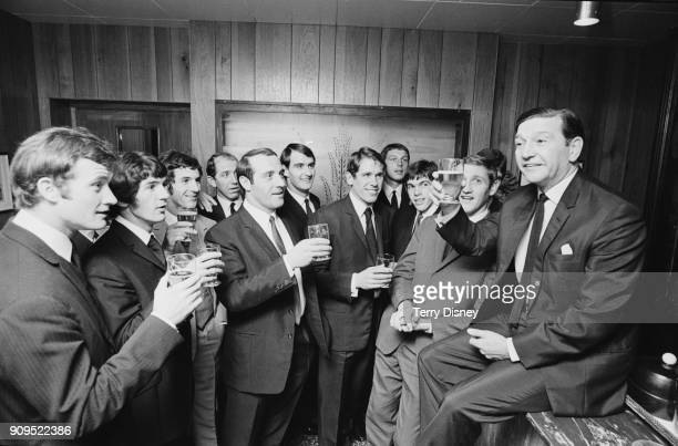 Twelve Queens Park Rangers FC players celebrates former manager Alec Stock with a 'champagne supper' at the Kensington Hotel London UK 26th November...