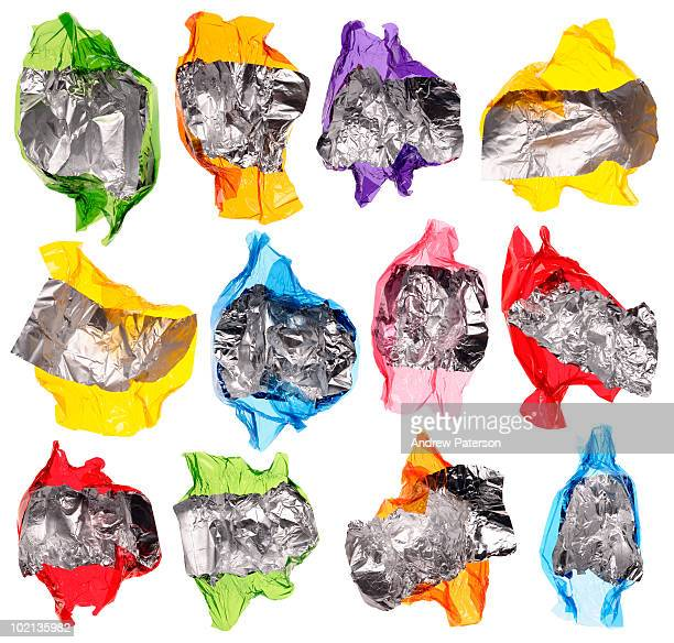 twelve sweet wrappers - candy wrapper stock photos and pictures