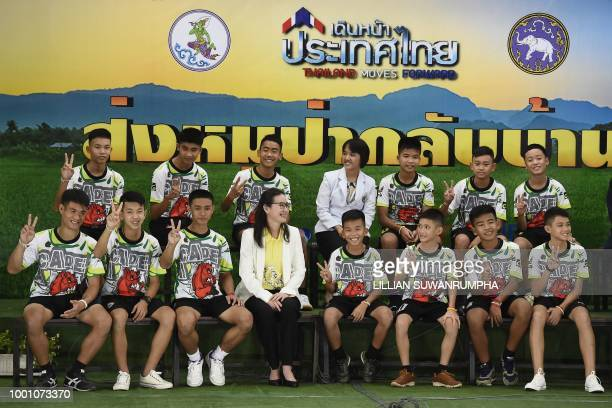 TOPSHOT Twelve Thai boys and their football coach rescued from a flooded cave after being trapped attend a press conference in Chiang Rai on July 18...
