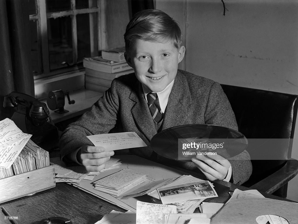 Twelve year old David Dimbleby, son of BBC commentator Richard, with a requested record for the 'Family Favourites' radio programme that he will present on Boxing Day.
