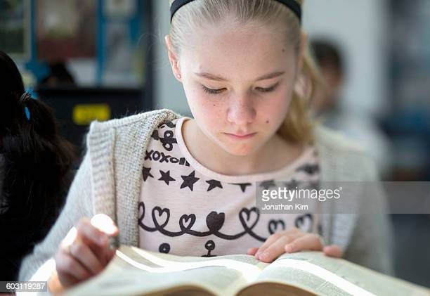 Twelve year old girl reads.