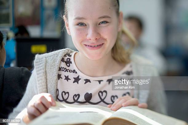 Twelve year old girl with a book.