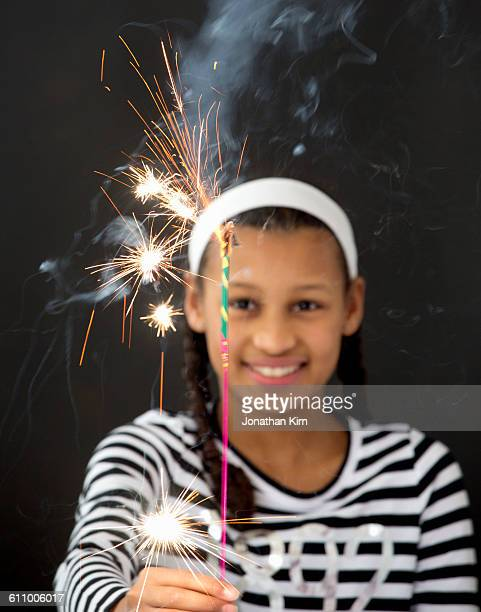 Twelve year old girl with sparkler.