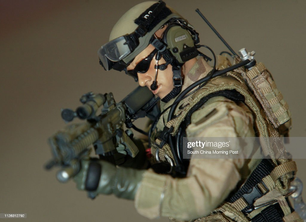 A twelve-inch US NAVY SEAL TEAM 8 action figure, US Miltary