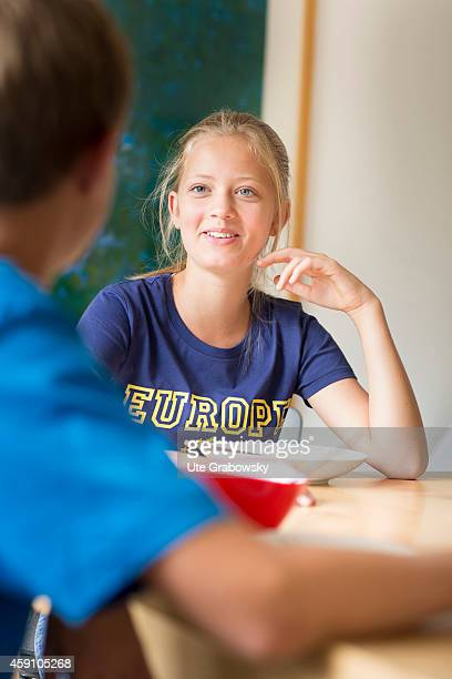 Twelveyearold girl and fourteenyearold boy having lunch at home on August 11 in Duelmen Germany Photo by Ute Grabowsky/Photothek via Getty Images
