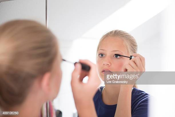 Twelveyearold girl applying mascara in front of a mirror on August 11 in Duelmen Germany Photo by Ute Grabowsky/Photothek via Getty Images