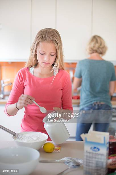 Twelveyearold girl baking a cake together with her mother on August 11 in Duelmen Germany Photo by Ute Grabowsky/Photothek via Getty Images