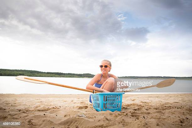 Twelveyearold girl sitting in a selfbuilt canoe on August 11 in Duelmen Germany Photo by Ute Grabowsky/Photothek via Getty Images