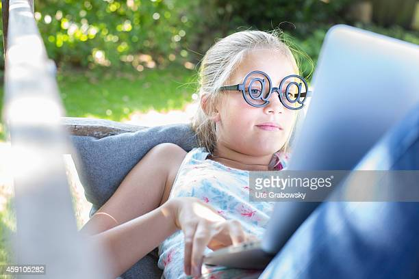 Twelveyearold girl wearing glasses with the at sign behind a laptop on August 11 in Duelmen Germany Photo by Ute Grabowsky/Photothek via Getty Images