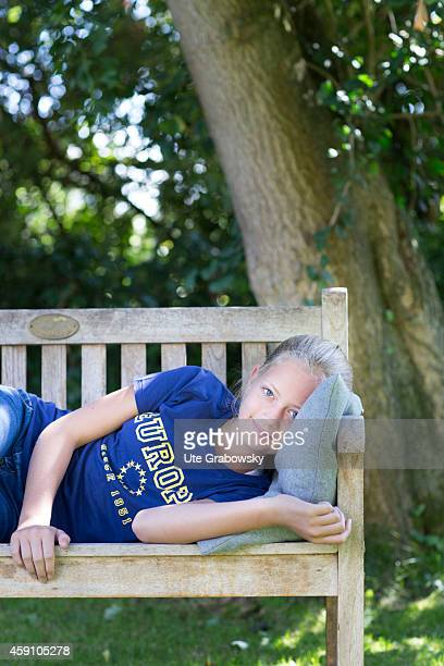 Twelveyearold girl with an Europe TShirt on a bench in a garden on August 11 in Duelmen Germany Photo by Ute Grabowsky/Photothek via Getty Images