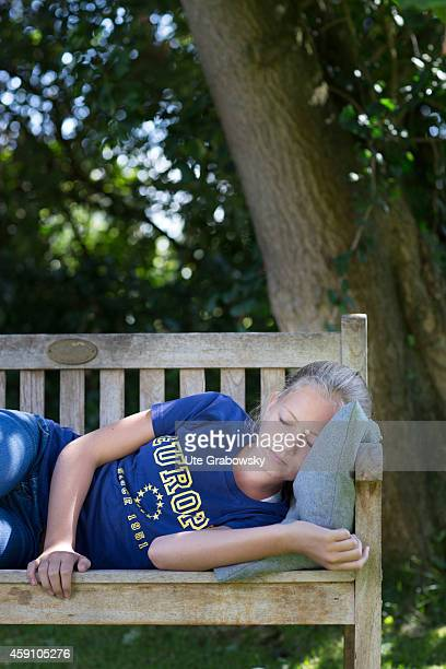 Twelveyearold girl with an Europe TShirt sleeping on a bench in a garden on August 11 in Duelmen Germany Photo by Ute Grabowsky/Photothek via Getty...