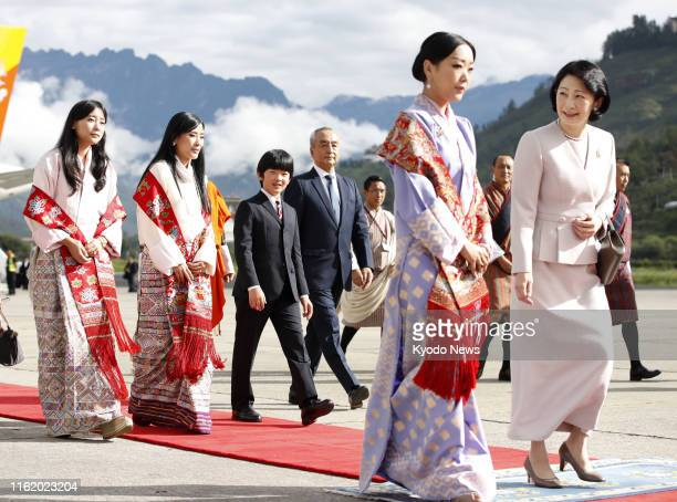 Twelveyearold Japanese Prince Hisahito arrives at Paro airport in Bhutan on Aug 17 with his mother Crown Princess Kiko for a private family trip...