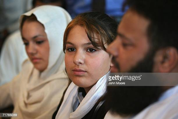 Twelveyearold Scottish schoolgirl Molly Campbell sits at a press conference while flanked by her Pakistani father Sajad Ahmed Rana and older sister...