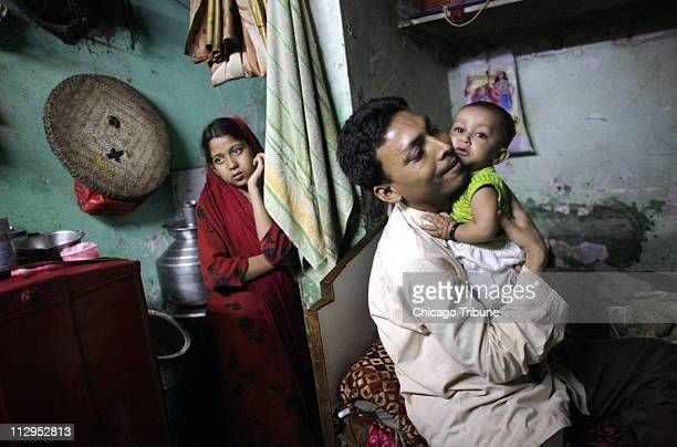 Twelveyearold Shehnaaz left is pictured February 26 with her father Sheik Samir Haq and baby sister in the room she shares with her parents and five...
