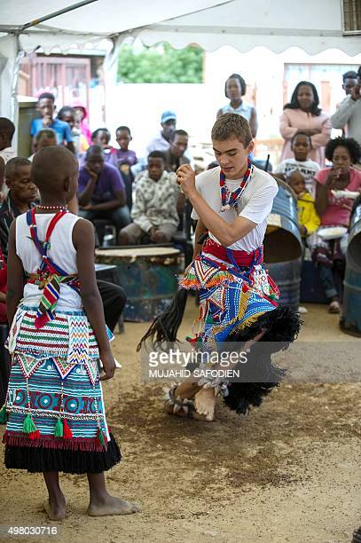 Twelveyearold South African Kyle Todd dances during his initiation ceremony to become a Sangoma or traditional healer at a traditional healer school...