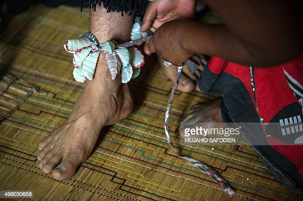 Twelveyearold South African Kyle Todd get dressed for his initiation ceremony to become a Sangoma or traditional healer at a traditional healer...