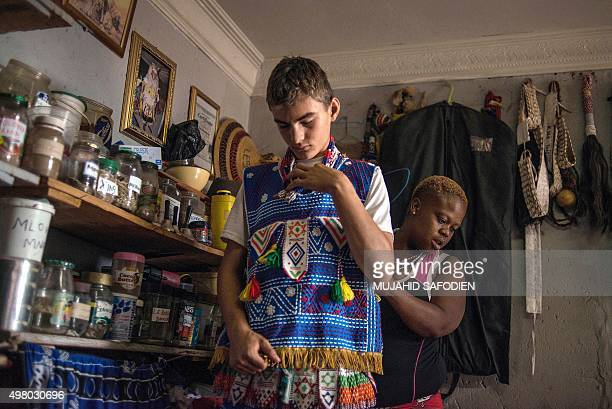 Twelveyearold South African Kyle Todd gets dressed for his initiation ceremony to become a Sangoma or traditional healer at a traditional healer...