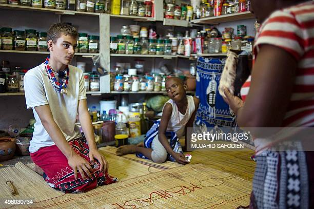 Twelveyearold South African Kyle Todd is given instructions before his initiation ceremony to become a Sangoma or traditional healer at a traditional...