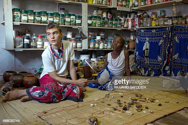 Twelveyearold South African Kyle Todd performs a divination by looking at bones and objects during his initiation ceremony to become a Sangoma or...