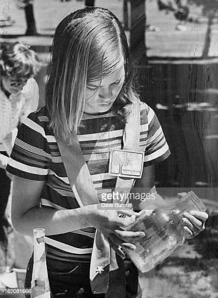 JUL 1 1974 JUL 3 1974 JUL 4 1974 Twelveyearold Teresa Langenderfer works on laminated tissue bottle she will lacquer