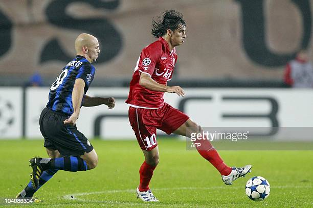 FC Twente Enschedeplayer Bryan Ruiz fights for the ball with Esteban Cambiasso of Inter Milan during their Champions League group A football match in...